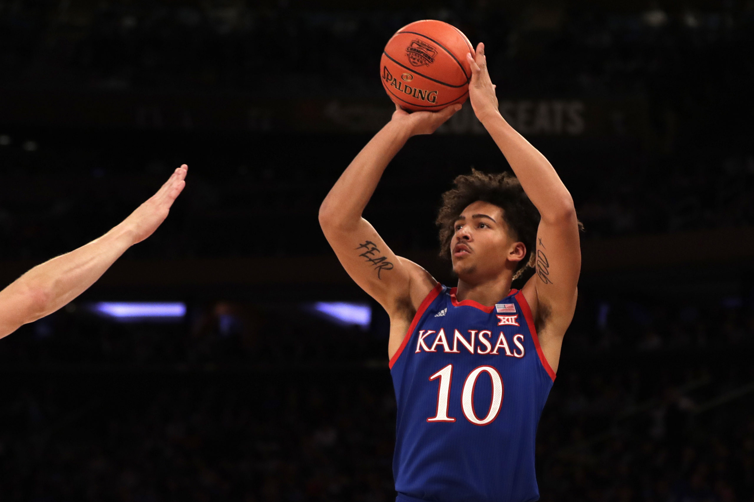 Jalen Wilson Takes a Jump Shot in College Basketball Action.