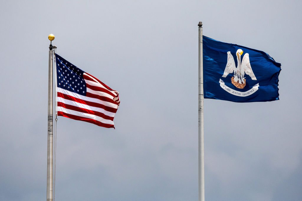 METAIRIE, LA - JUNE 25: The American Flag and Louisiana State Flag waving in the breeze during the minor league game between the Colorado Springs Sky Sox and the New Orleans Baby Cakes on June 25, 2017 at Zephyr Field in Metairie, LA. New Orleans Baby Cakes won 7-1. (Photo by Stephen Lew/Icon Sportswire via Getty Images)