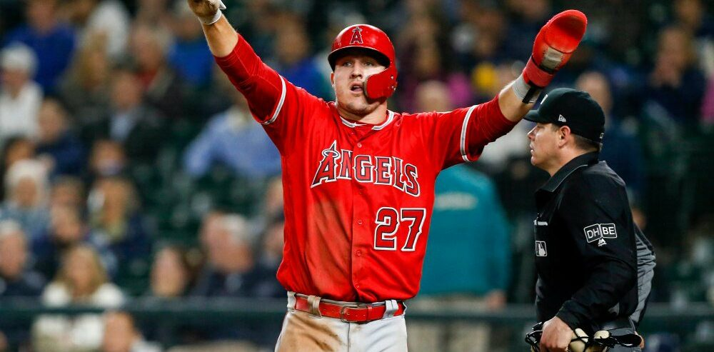 May 5, 2018; Seattle, WA, USA; Los Angeles Angels center fielder Mike Trout (27) reacts after scoring a run against the Seattle Mariners during the eleventh inning at Safeco Field. Mandatory Credit: Joe Nicholson-USA TODAY Sports ORG XMIT: USATSI-375164 ORIG FILE ID:  20180504_pjc_sn8_738.JPG