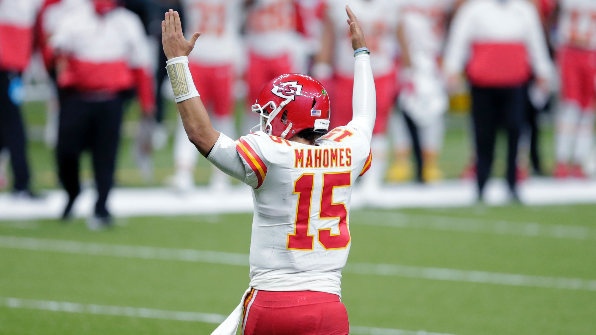 Kansas City Chiefs quarterback Patrick Mahomes (15) reacts after a touchdown by running back Le'Veon Bell in the second half of an NFL football game against the New Orleans Saints in New Orleans, Sunday, Dec. 20, 2020. (AP Photo/Brett Duke)