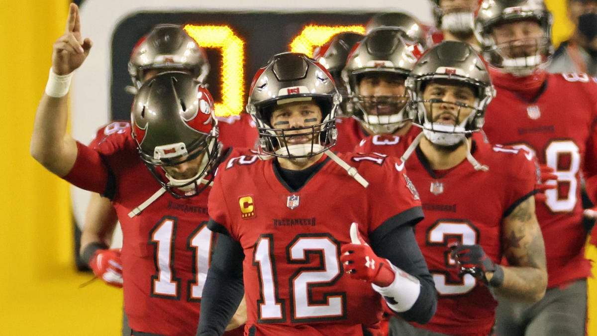Jan 9, 2021; Landover, Maryland, USA; Tampa Bay Buccaneers quarterback Tom Brady (12) leads his team onto the field prior to their game against the Washington Football Team at FedExField. Mandatory Credit: Geoff Burke-USA TODAY Sports