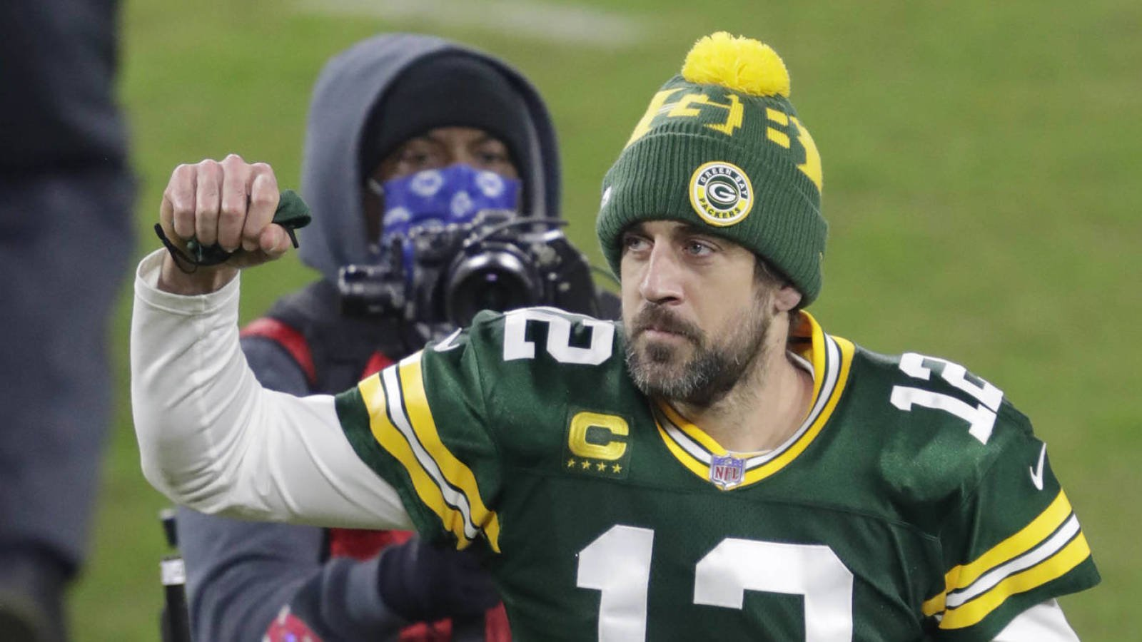 Jan 16, 2021; Green Bay, WI, USA;  Green Bay Packers quarterback Aaron Rodgers (12) celebrates a victory against the Los Angeles Rams during their NFL divisional playoff game Saturday, January 16, 2021, at Lambeau Field in Green Bay, Wis.  Mandatory Credit: Dan Powers-USA TODAY NETWORK